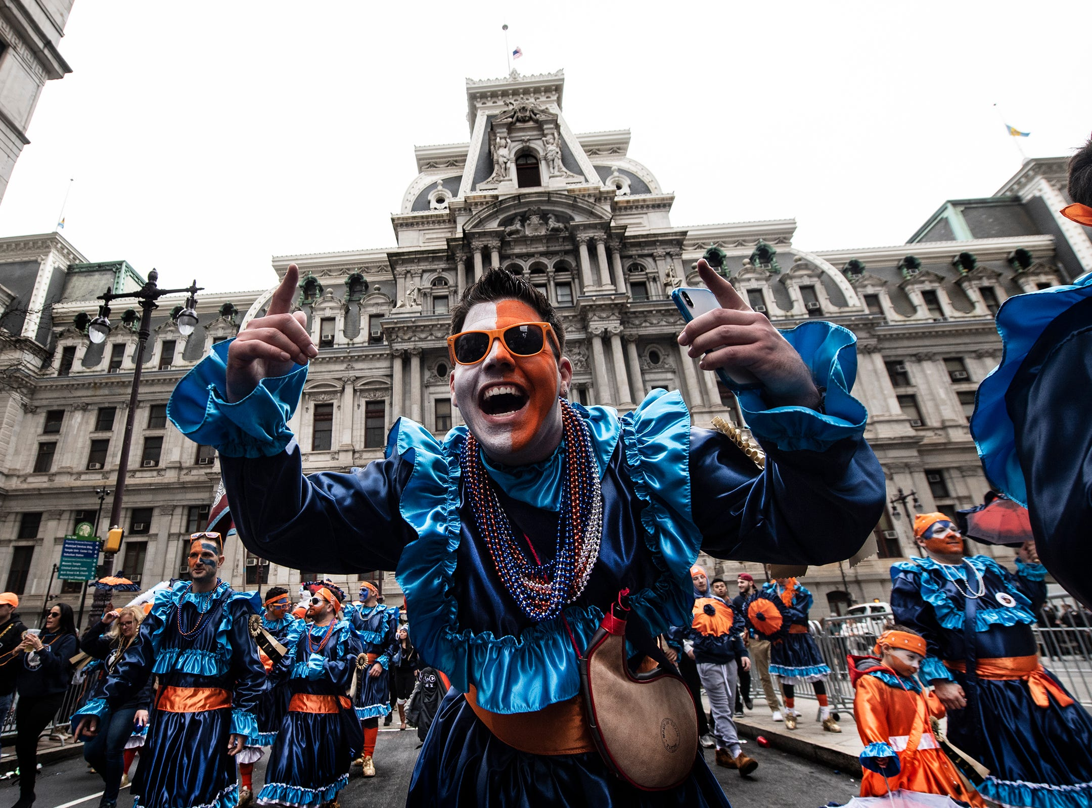 Members of The Holy Rollers N.Y.B., struts down Broad Street during the Mummers Parade, Tuesday, Jan. 1, 2019, in Philadelphia. (David Maialetti/The Philadelphia Inquirer via AP)