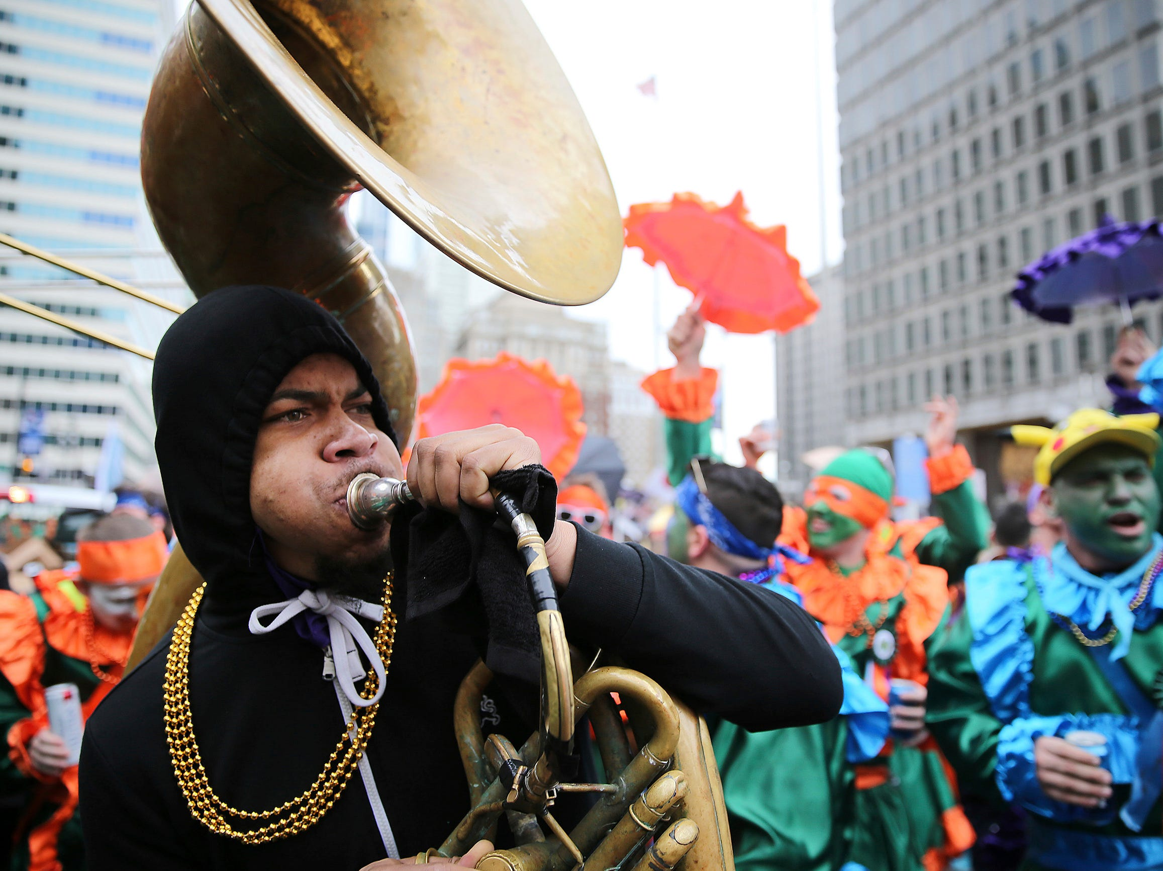 Devoe White plays a sousaphone as members of the Saints Wench Brigade dance in front of City Hall during the Mummers Parade, Tuesday, Jan. 1, 2019, in Philadelphia. (David Maialetti/The Philadelphia Inquirer via AP)