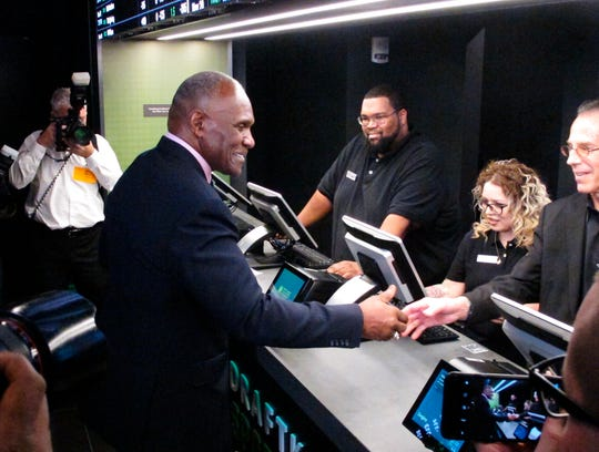 In this Nov. 20, 2018 file photo, former New York Giants linebacker Harry Carson places a bet on the New York Yankees to win the 2019 World Series at Resorts Casino in Atlantic City, N.J.  The race to legalize sports betting is on now that the U.S. Supreme Court has allowed it in all 50 states, but will it provide enough extra tax revenue to make much of a difference for schools, roads or pension debt? (AP Photo/Wayne Parry)