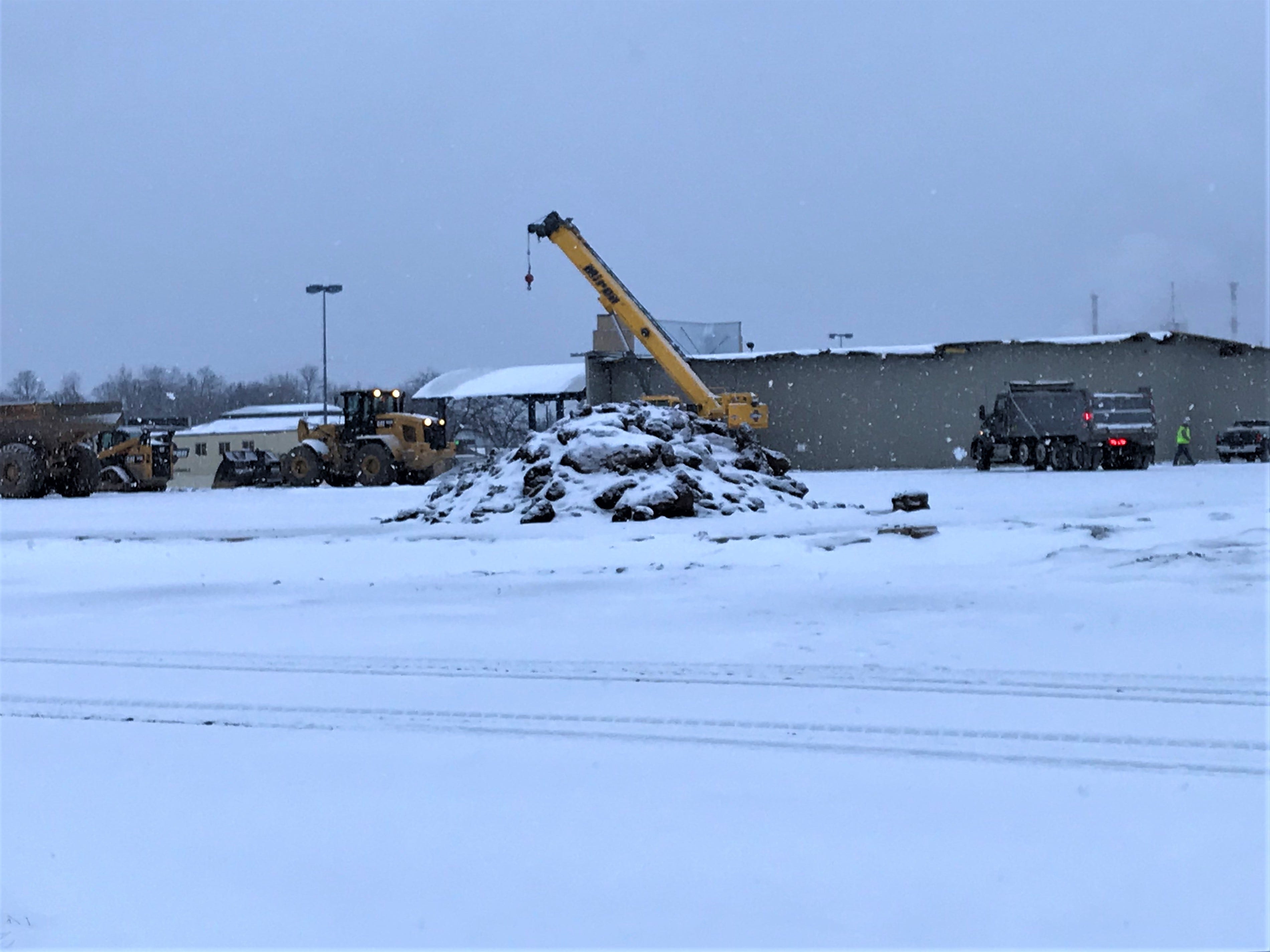 Crews work at the former Rapids Mall site Jan. 2, 2019. Equipment stands where Younkers used to be.
