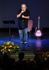 Johnny Divine thanks the crowd at Wichita Theatre Wednesday during a celebration of life for his son, Jimi Divine, 32, who passed away suddenly last week.