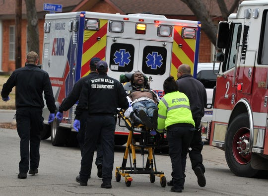 Wichita Falls emergency medical responders work to transport a possible combative patient after responding to a medical call in the 800 block of Juarez Street, Tuesday afternoon.