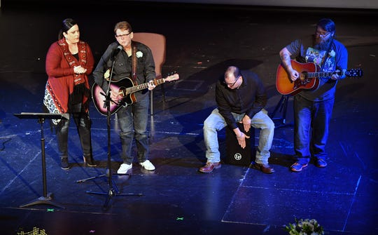 Members of the band Barefoot Dixie play a song for their bandmate, Jimi Divine, who died suddenly December 26th. A celebration of his life was held Wednesday at the Wichita Theatre.