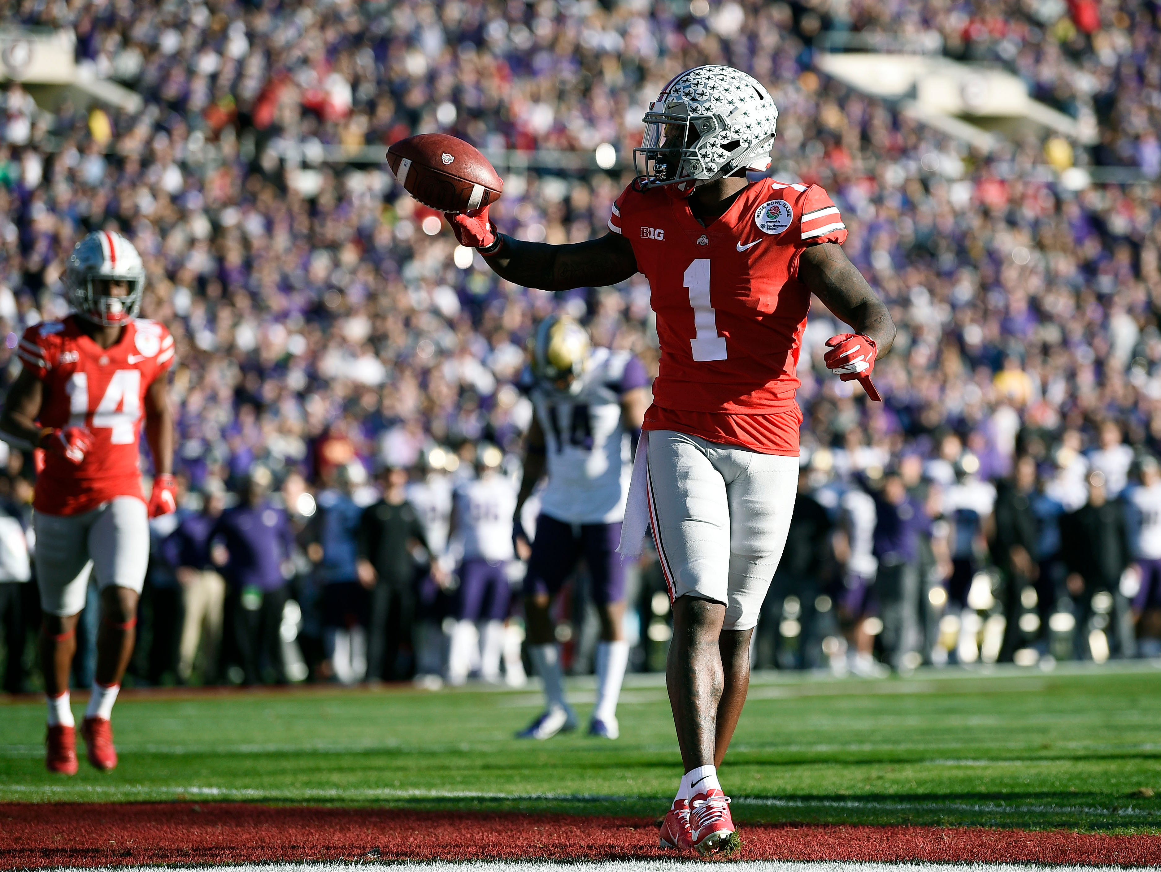 Ohio State Buckeyes wide receiver Johnnie Dixon (1) celebrates after scoring a touchdown in the second quarter against the Washington Huskies in the Rose Bowl.