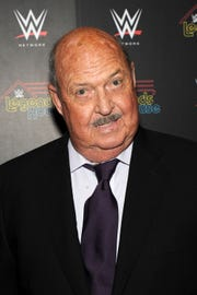 "Cast member Gene Okerlund attends the WWE screening of ""Legends' House"" at Smith & Wollensky on April 15, 2014 in New York City. Longtime World Wrestling Entertainment personality Gene Okerlund has died at the age of 76, the WWE announced Jan. 2, 2019."