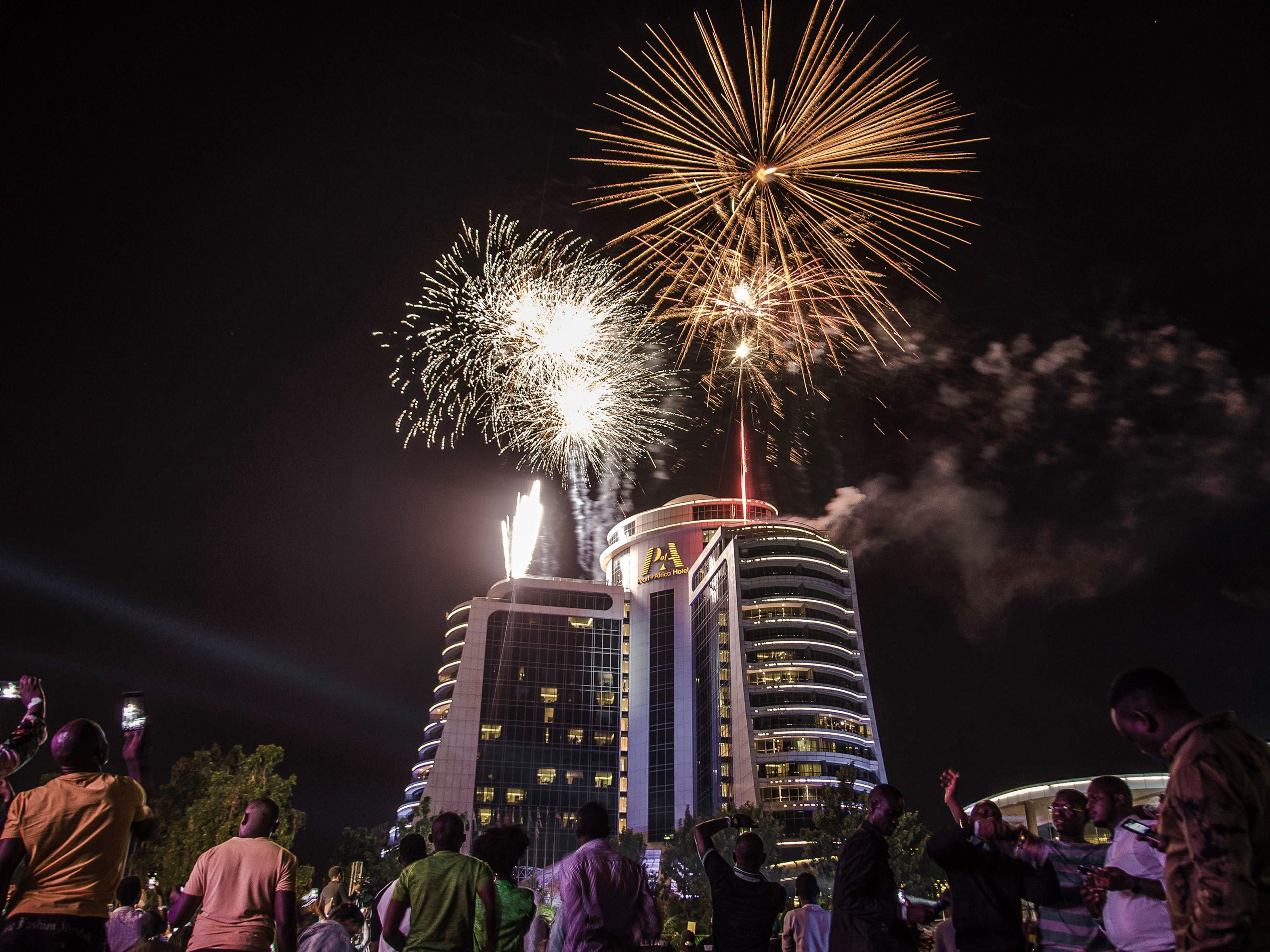 People watch fireworks launching at the Pearl of Africa Hotel to celebrate a New Year in Kampala on January 1, 2019. (Photo by Badru Katumba / AFP)BADRU KATUMBA/AFP/Getty Images ORIG FILE ID: AFP_1BX0XE