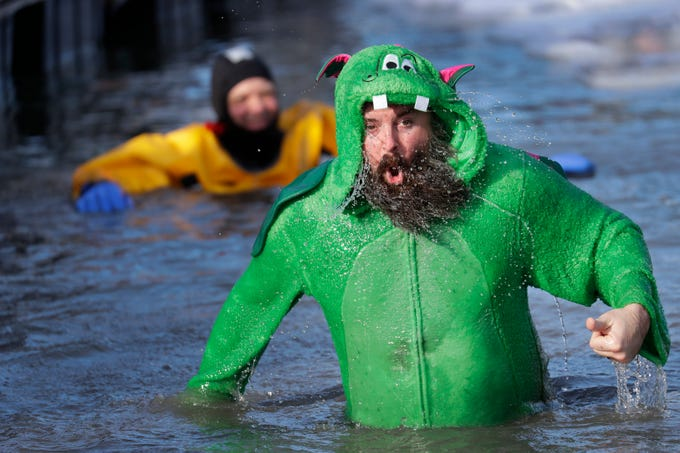 Danny Fili emerges from the frigid water during the Polar Bear Plunge at Becker Marine on Lime Kiln Lake in Waupaca, Wis.