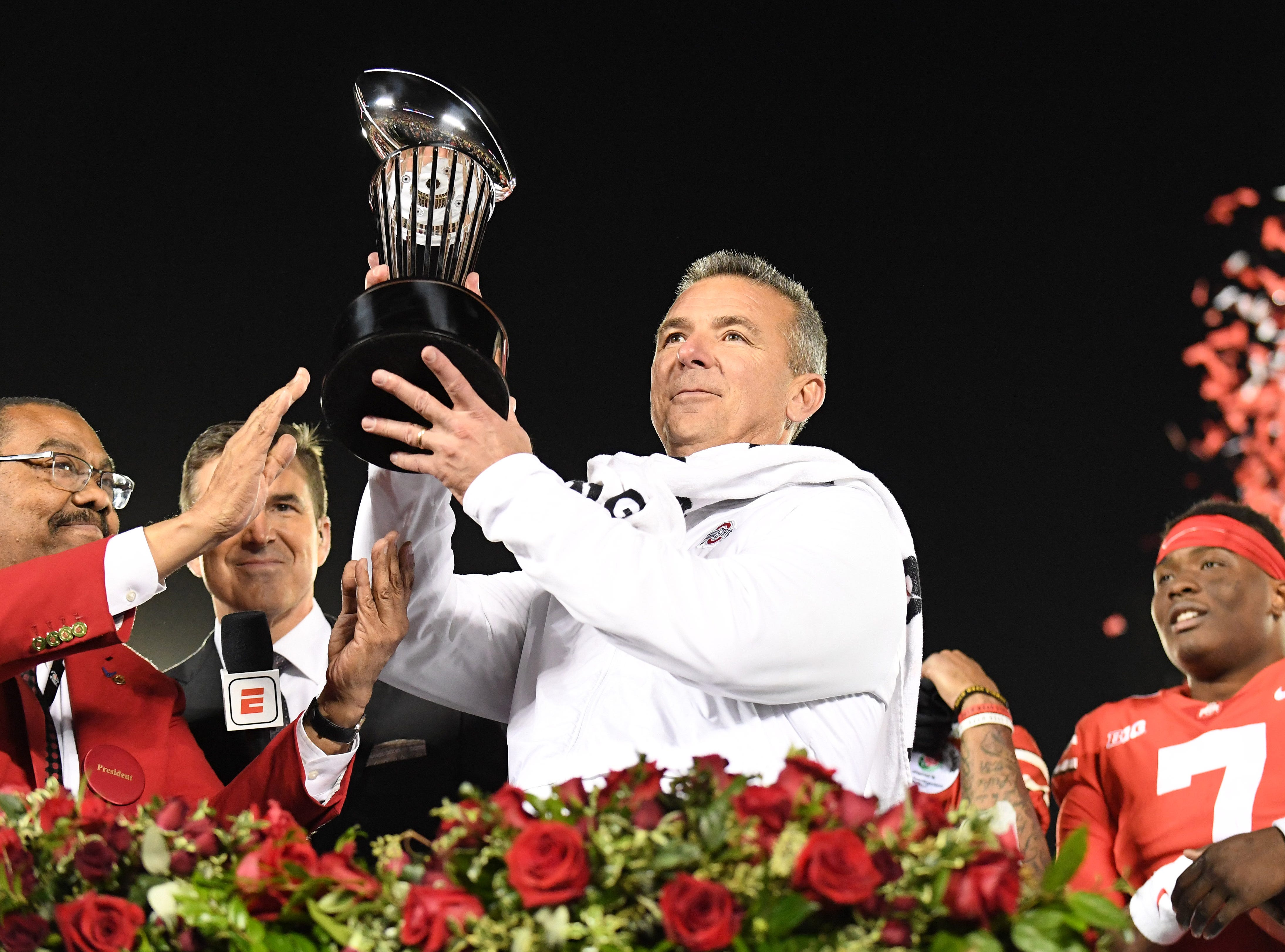 Ohio State Buckeyes head coach Urban Meyer celebrates with the Rose Bowl trophy after beating the Washington Huskies.