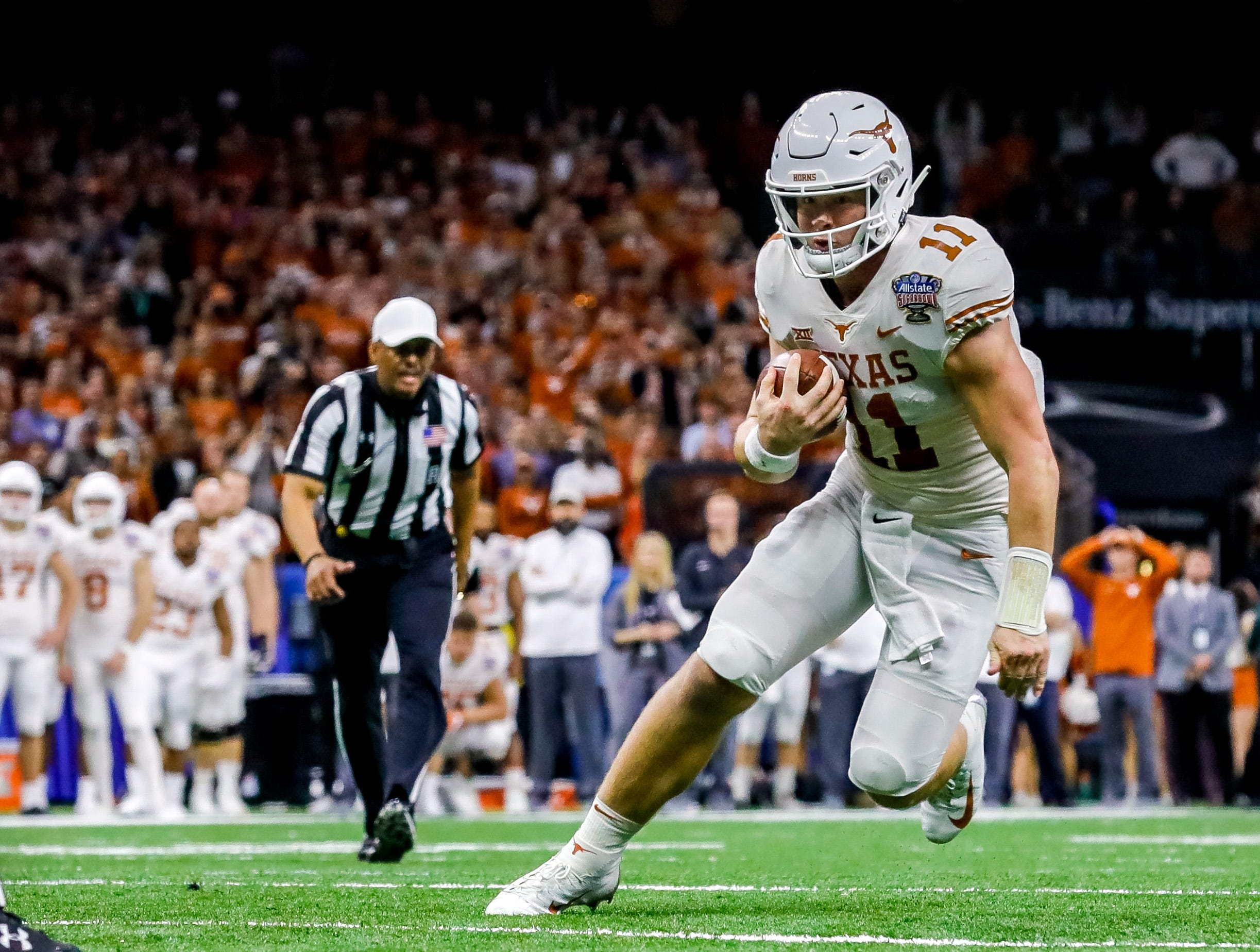 Texas Longhorns quarterback Sam Ehlinger (11) scrambles for a touchdown against the Georgia Bulldogs in the second quarter of the Sugar Bowl.