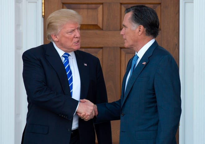 Donald Trump and Mitt Romney in happier times.