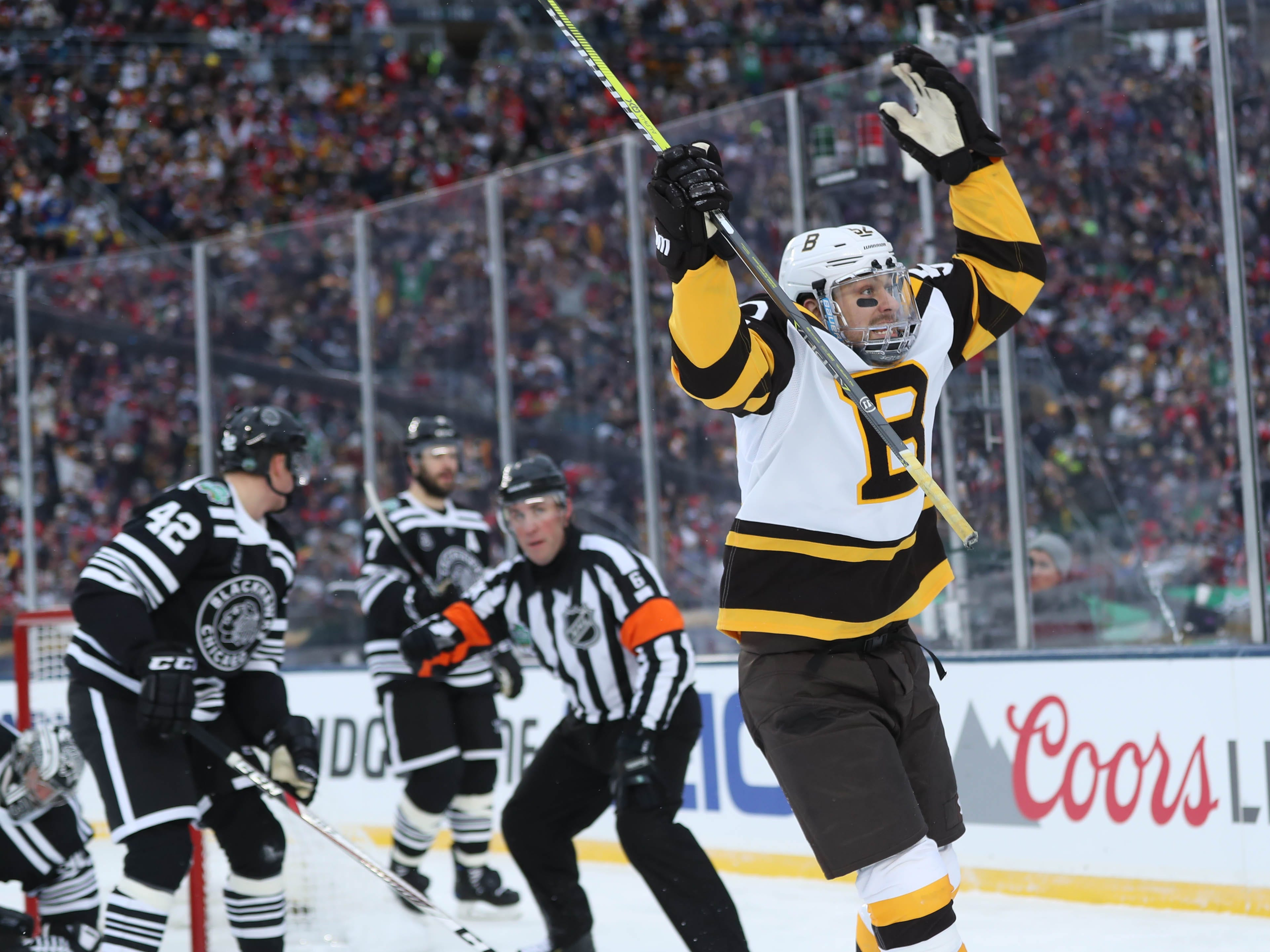 Jan. 1: Boston Bruins center Sean Kuraly celebrates his third-period goal against the Chicago Blackhawks in the 2019 Winter Classic. It was his second consecutive game-winning goal.