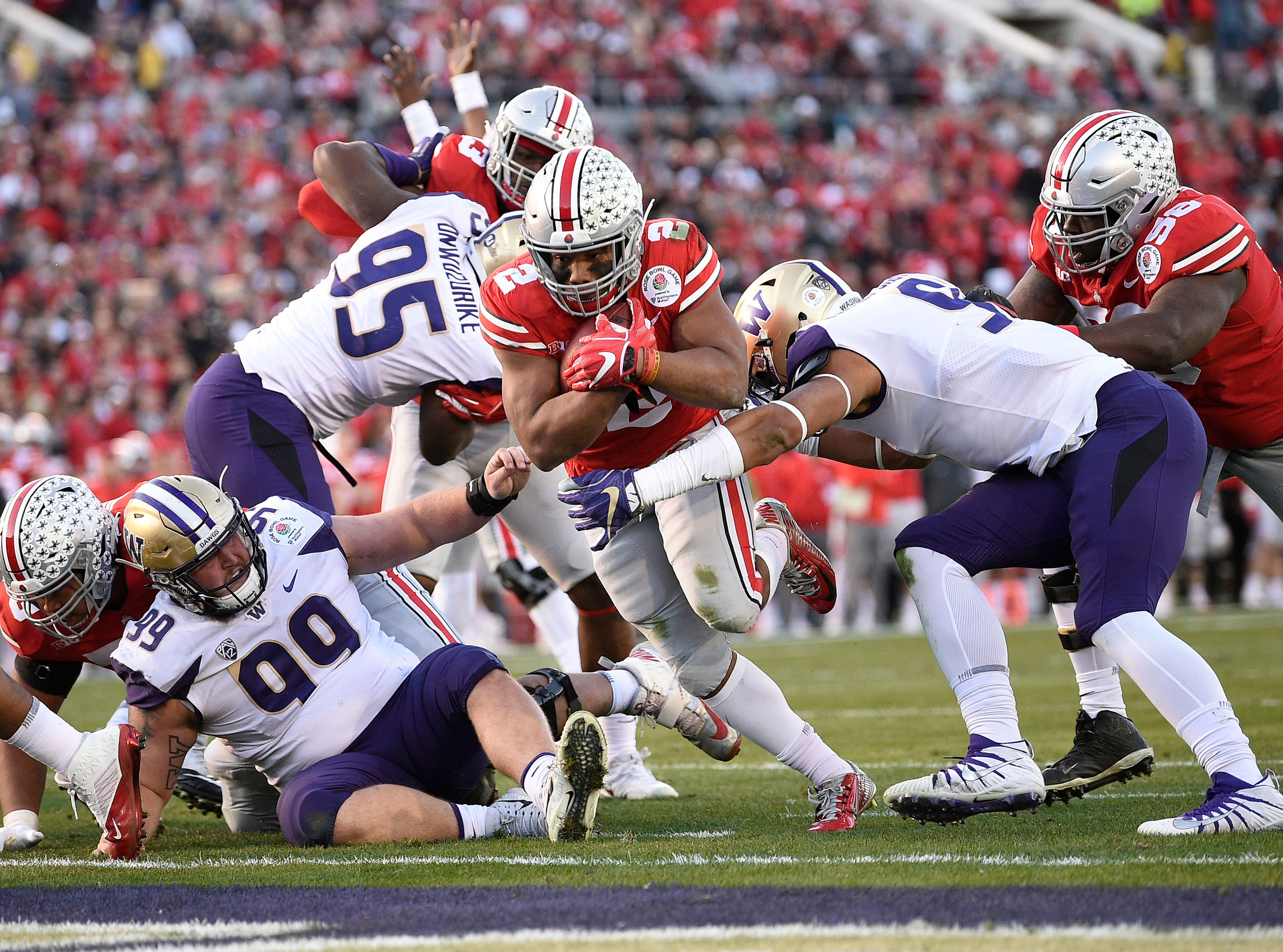Ohio State Buckeyes running back J.K. Dobbins (2) runs in a touchdown against the Washington Huskies in the third quarter in the Rose Bowl.