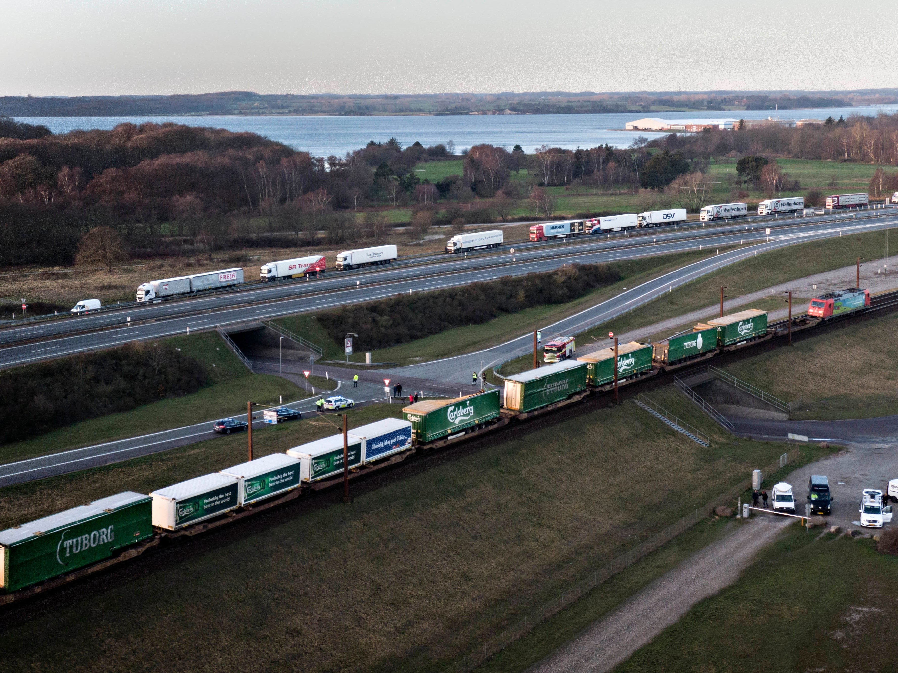 A aerial view of a cargo train with damaged compartments near the Storebaelt bridge, near Nyborg in Denmark, Wednesday, Jan. 2, 2019. Danish police say several people have been killed in a train accident on a bridge linking the central islands of Zealand and Funen. Police did not provide further details about those killed or the number of people injured in Wednesday's incident, which took place about 8 a.m. local time. Danish media reported that a tarpaulin on a freight train hit a passenger train going in the opposite direction, prompting it to brake suddenly. (Michael Bager/Ritzau Scanpix via AP) ORG XMIT: TH808