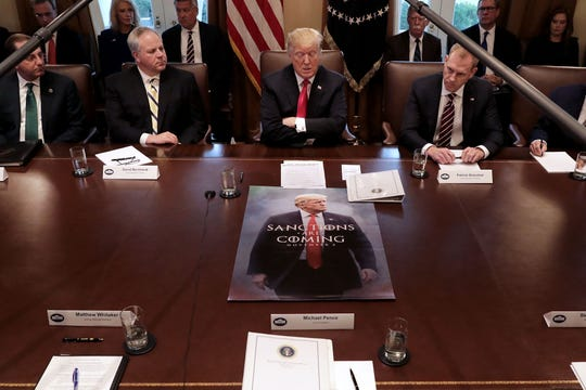 President Donald Trump leads a meeting of his Cabinet, including, left to right, Health and Human Services Secretary Alex Azar, acting Interior Secretary David Bernhardt, and acting Defense Secretary Patrick Shanahan, at the White House Jan. 2, 2019, in Washington, D.C.