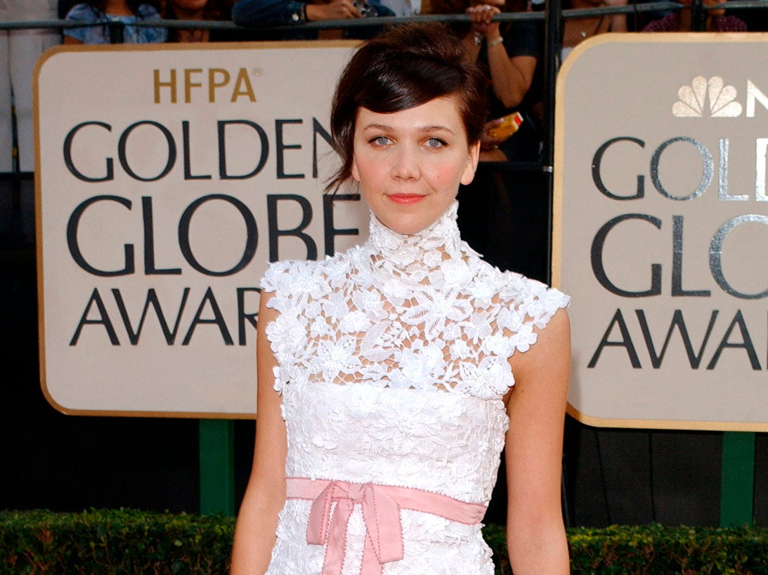 """Maggie Gyllenhaal, nominated for best performance by an actress in a motion picture-musical or comedy for her work in """"Secretary,"""" arrives for the 60th Annual Golden Globe Awards, in Beverly Hills, Calif., Sunday, Jan. 19, 2003. (AP Photo/Kim D. Johnson) ORG XMIT: GGA153"""