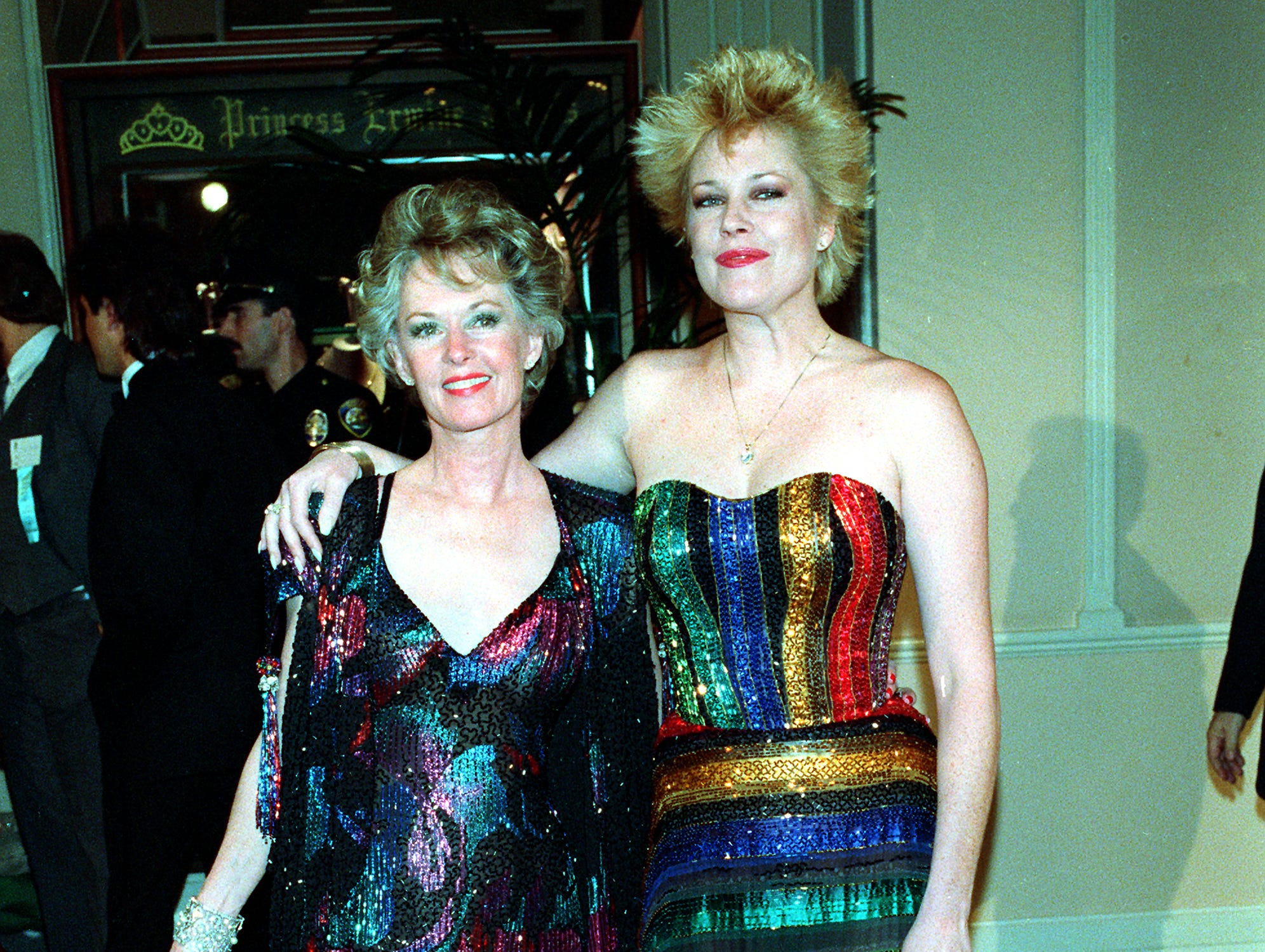 """Actress Tippi Hedren, left, and her daughter, actress Melanie Griffith, pose at the 44th annual Golden Globe Awards in Los Angeles, Ca., Jan. 31, 1987.  Griffith is nominated in the category of best performance by an actress in a musical or comedy for her role in """"Something Wild.""""  (AP Photo/Avery) ORG XMIT: APHS124 [Via MerlinFTP Drop]"""