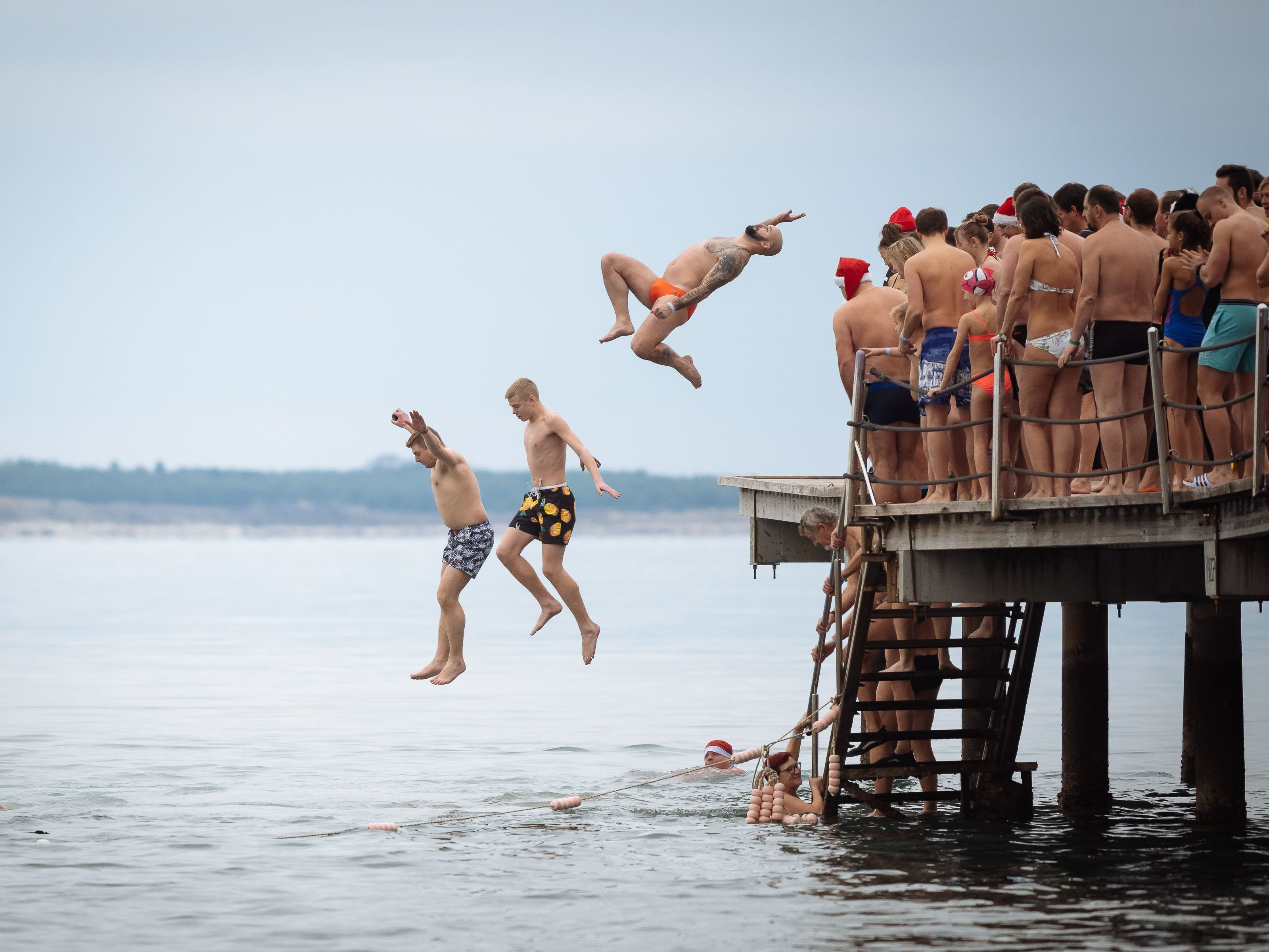 People jump into the water during a traditional New Year's swim in the Adriatic sea in Portoroz, Slovenia.