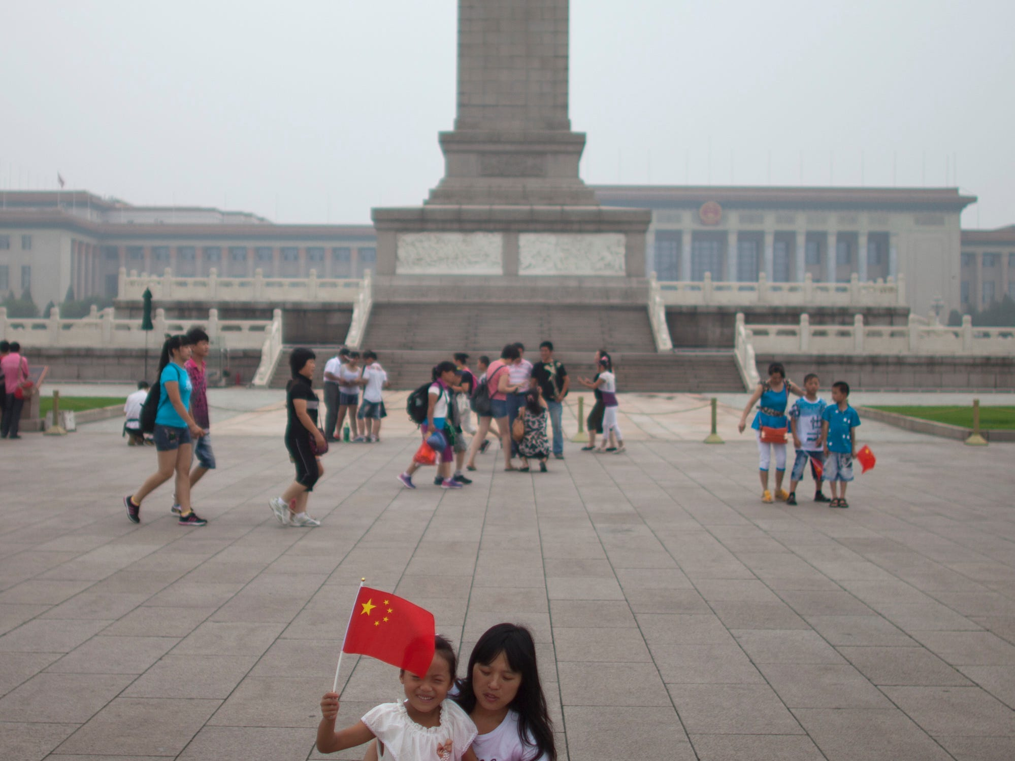 This is the Monument to the People's Heroes on the Tiananmen Square in Beijing. Tiananmen Square, the world's largest public square, is surrounded by buildings of political and cultural significance and is visited by thousands of tourists daily.