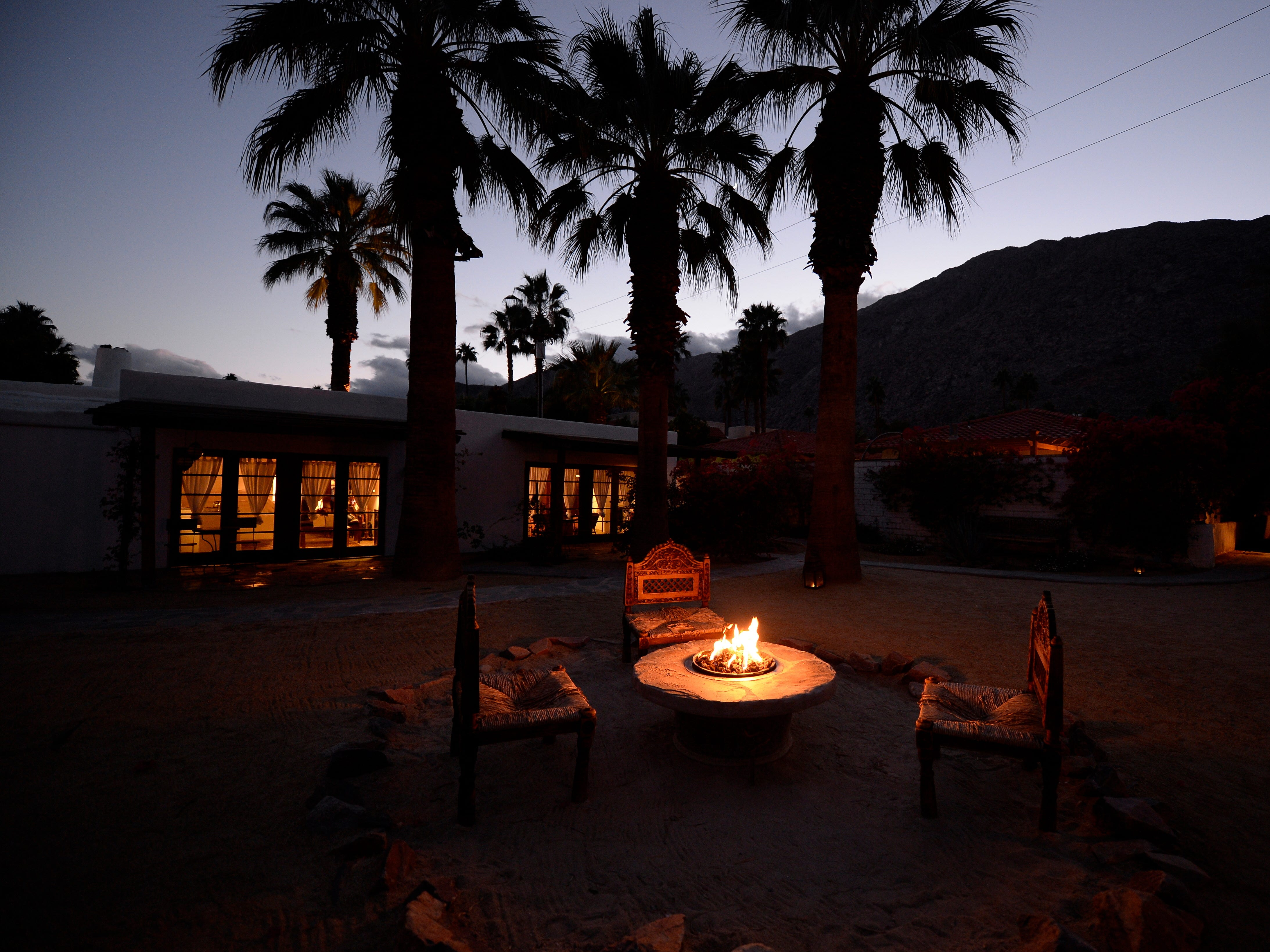 Palm Springs, California, is one of Travelzoo's top picks for affordable places to travel in the USA in January.  This is the Korakia Pensione, a bed-and-breakfast hotel housed in two restored historic Mediterranean-style estates. The hotel lights more than 200 candles and several fire places each evening around the property.