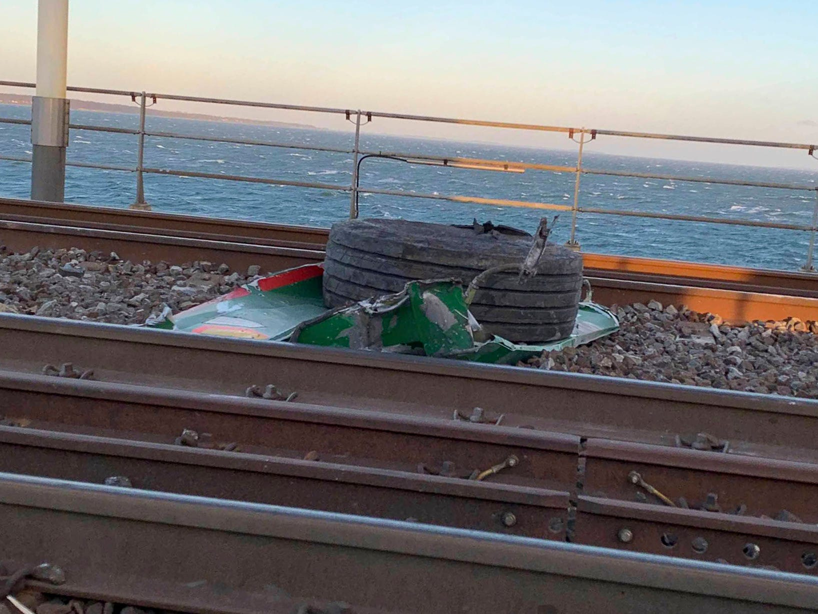 "In this UGC photo made available by a source wishing to remain anonymous, a view of debris on the tracks after a train accident on the Great Belt Bridge, in Nyborg, Denmark, Wednesday, Jan. 2, 2019. At least six people were killed in a train accident early Wednesday on a Danish bridge linking the central islands of Zealand and Funen, according to the rail operator. Authorities said several others were injured. Police spokesman Lars Braemhoej said that while ""we do not know precisely what caused the accident,"" one possible cause was that cargo from a passing freight train fell off and hit the passenger train. He added there was ""considerable damage"" on the passenger train.  (Anonymous Source via AP) ORG XMIT: AMB810"