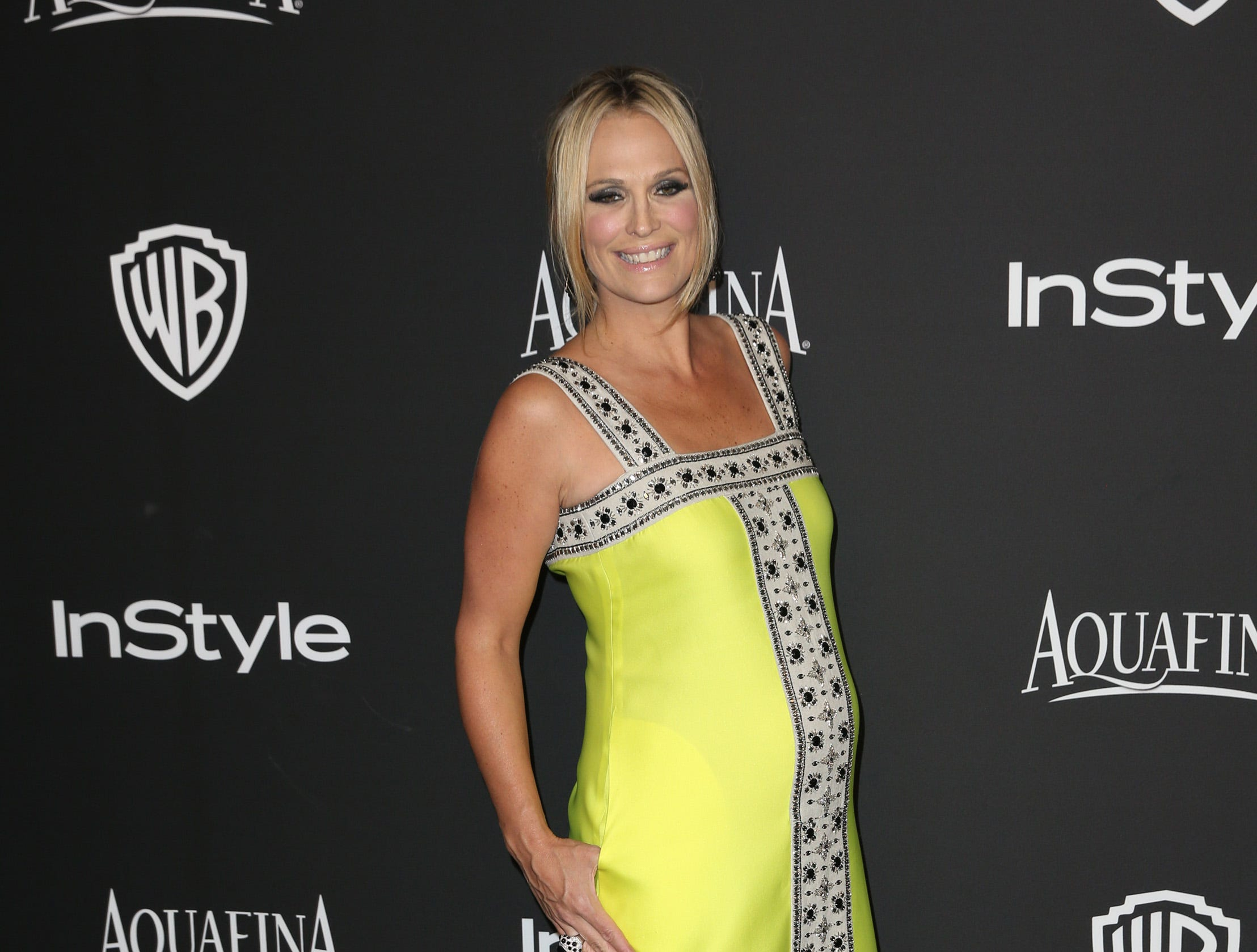 Molly Sims arrives at the 16th annual InStyle and Warner Bros. Golden Globes afterparty at the Beverly Hilton Hotel on Sunday, Jan. 11, 2015, in Beverly Hills, Calif. (Photo by Matt Sayles/Invision/AP) ORG XMIT: CAAK105