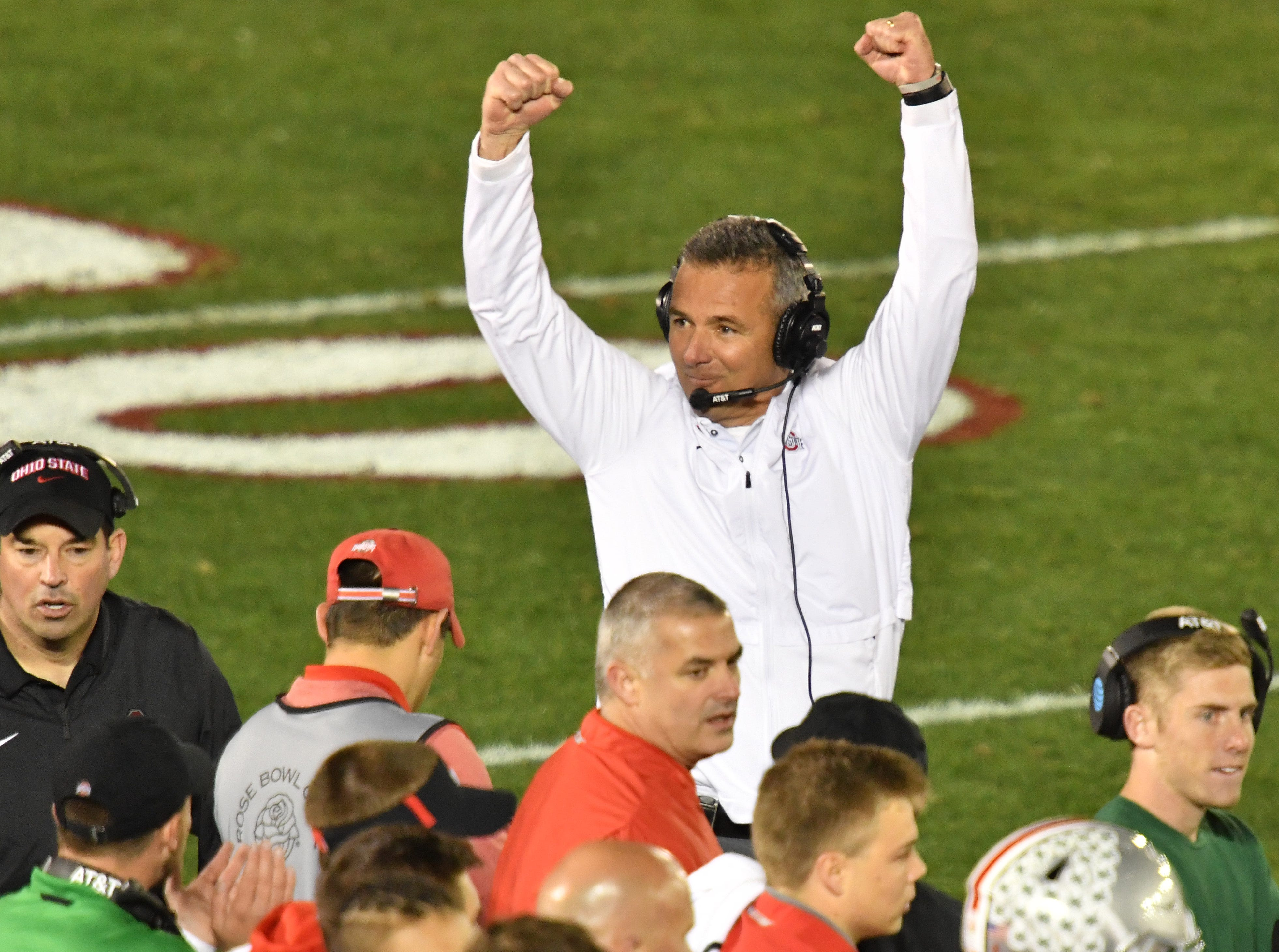 Ohio State Buckeyes head coach Urban Meyer celebrates the win over the Washington Huskies in the Rose Bowl.