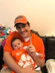 Marshall Creamer celebrates Clemson's national championship win in 2017 with his son in Hong Kong.