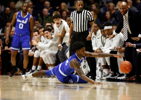 Seton Hall Pirates guard Myles Cale (22) reaches for the ball during the first half against the Xavier Musketeers at the Cintas Center.