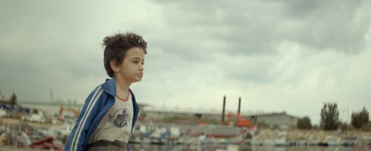 "Zain Al Rafeea as Zain in ""Capernaum."""