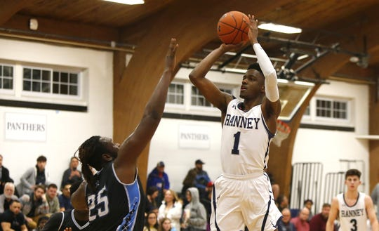 Bryan Antoine (1) of Ranney School shoots over Landonn Fitzpatrick (25) of Asbury Park during boys high school basketball in Tinton Falls, N.J. Thursday, December 20, 2018 Noah K. Murray-Correspondent/Asbury Park Press