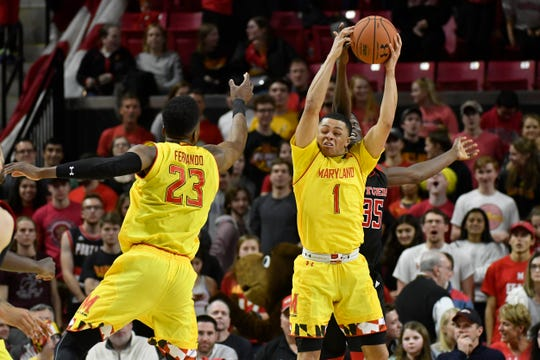 Maryland Terrapins guard Anthony Cowan (1) steals a pass inter for Rutgers Scarlet Knights guard Issa Thiam (35) during the second half at XFINITY Center.