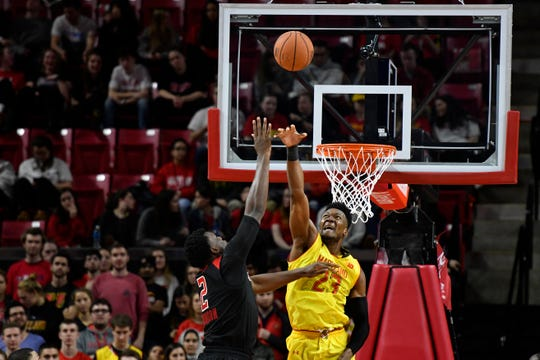 Rutgers Scarlet Knights center Shaquille Doorson (2) shoots a as Maryland Terrapins forward Bruno Fernando (23) defends in 2018