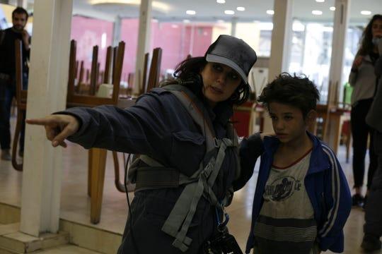 "Director Nadine Labaki, left, and star Zain Al Rafeea on the set of ""Capernaum."""