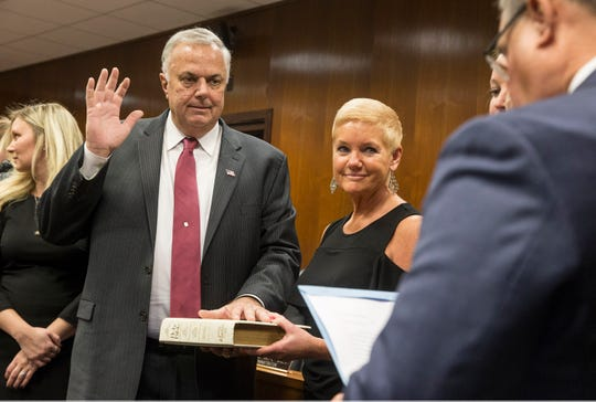 Former Lacey Mayor Gary Quinn is administered the oath of office for freeholder by state Sen. Christopher J. Connors, R-Ocean, as his wife Linda and members of the Quinn family look on.