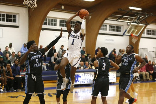 Bryan Antoine (1) of Ranney School goes to the basket against Asbury Park defenders during boys high school basketball in Tinton Falls, N.J. Thursday, December 20, 2018 Noah K. Murray-Correspondent/Asbury Park Press