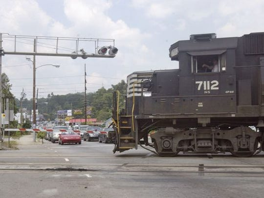 Trains passing through the Biltmore Village area -- and stopping traffic on Biltmore Avenue -- are a common sight in Asheville.