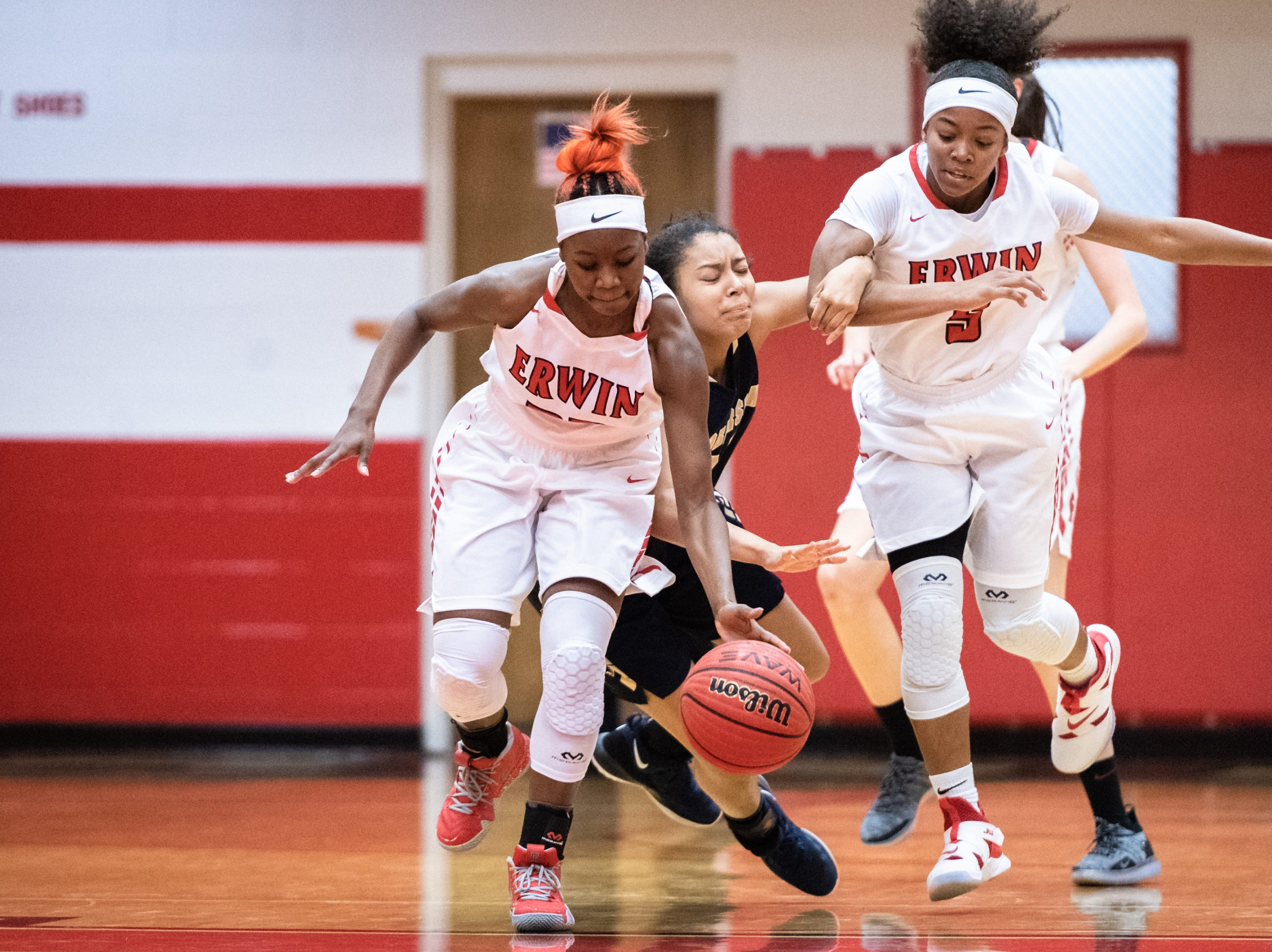 Erwin's Nautica Smiley steals the ball from Roberson's Zy-nice Lane with defensive assistance from Jaia Wilson during their game Jan. 2, 2018.