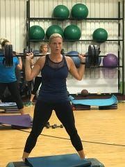 This July 2017 photo shows Jill Lauer during a fitness class at Minges Creek Athletic Club. Lauer followed through on her New Year resolution to be a healthier person.