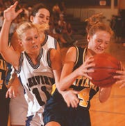 In this 1998 photo, Lakeview's Jill Edwards (11) goes for a lose ball against Mattawan.
