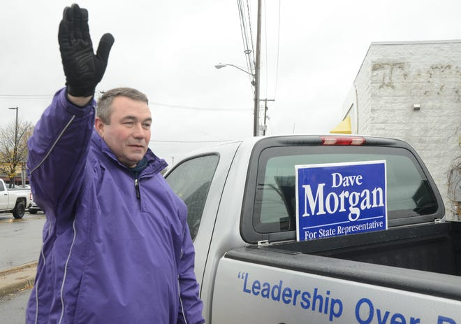 Dave Morgan campaigning on election day at the corner of Capital and Columbia Avenues.