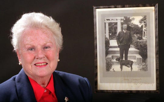 1998: Sandy Scanlon, grandaughter of George F. Johnson, founder of Endicott Johnson, with a picture of her grandfather and his dog.