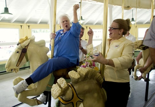 Sandra Scanlon, left, granddaughter of George F. Johnson, and her daughter, Kim Morris, take a ride on the CFJ carousel following a 2010 rededication ceremony during Carousel Day at CFJ Park in Johnson City.