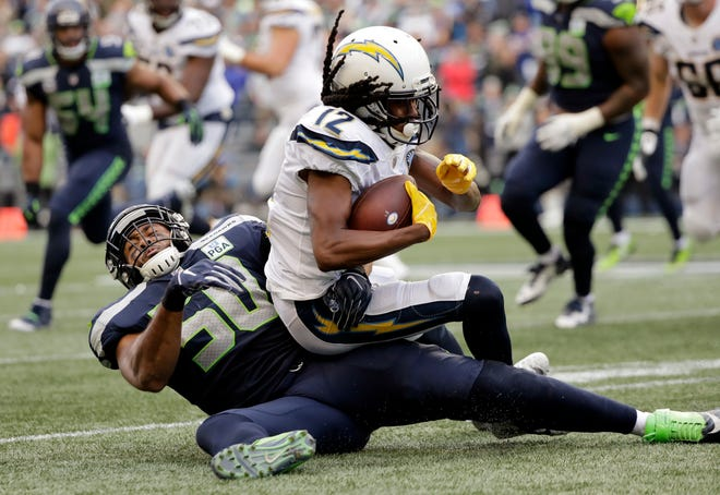 Seahawks linebacker K.J. Wright (50) tackles Travis Benjamin of the Chargers during a Nov. 4 game in Seattle. Wright missed 13 games with injury this year, but appears to be rounding into shape as the playoffs begin.