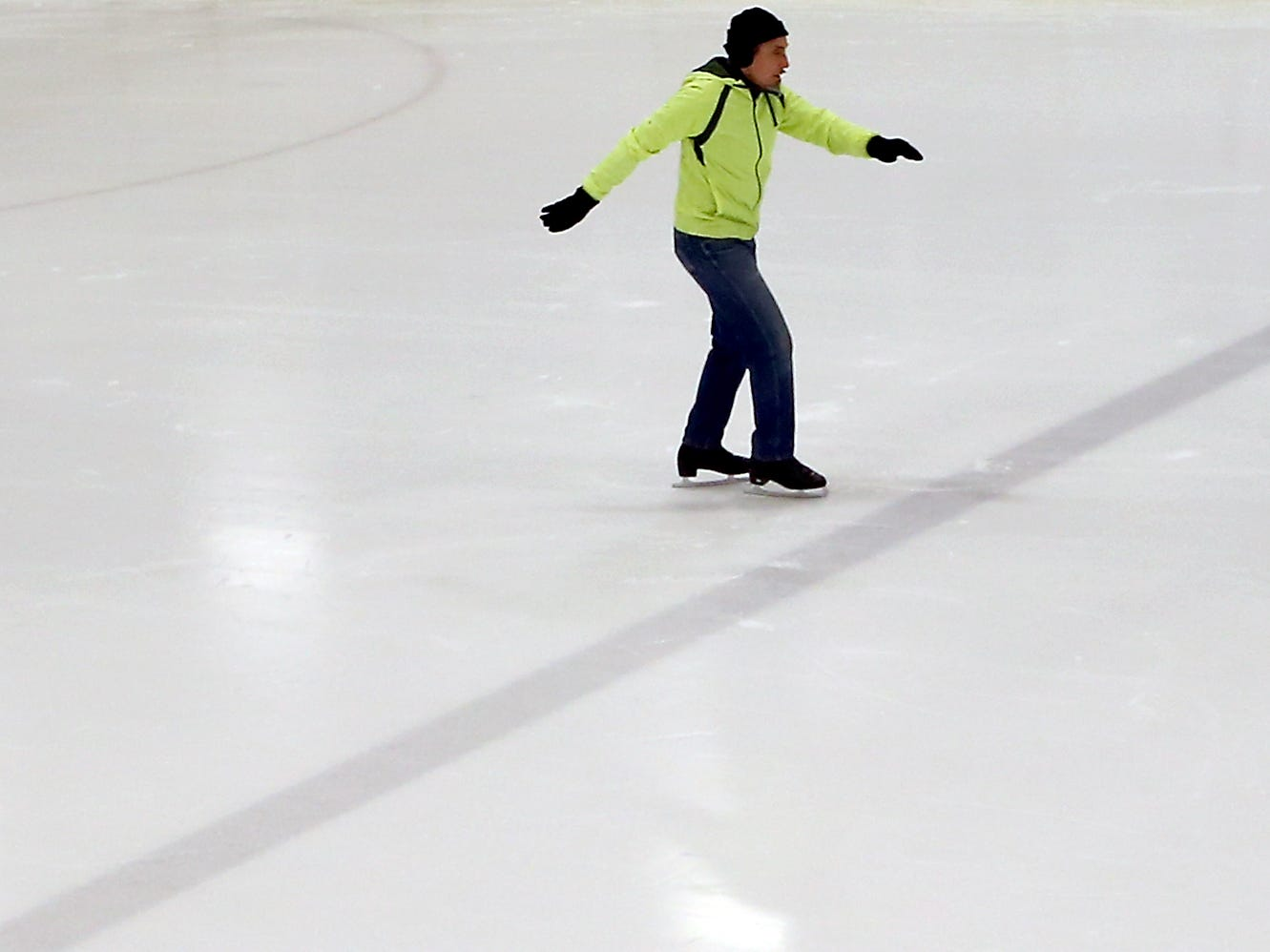 Glenn Stieber, 76, of Bremerton glides across the ice during Senior Skate at the Bremerton Ice Center on Thursday, January 3, 2019. Stieber used to compete as a roller figure skater and visits the rink every week for the Senior Skate event.