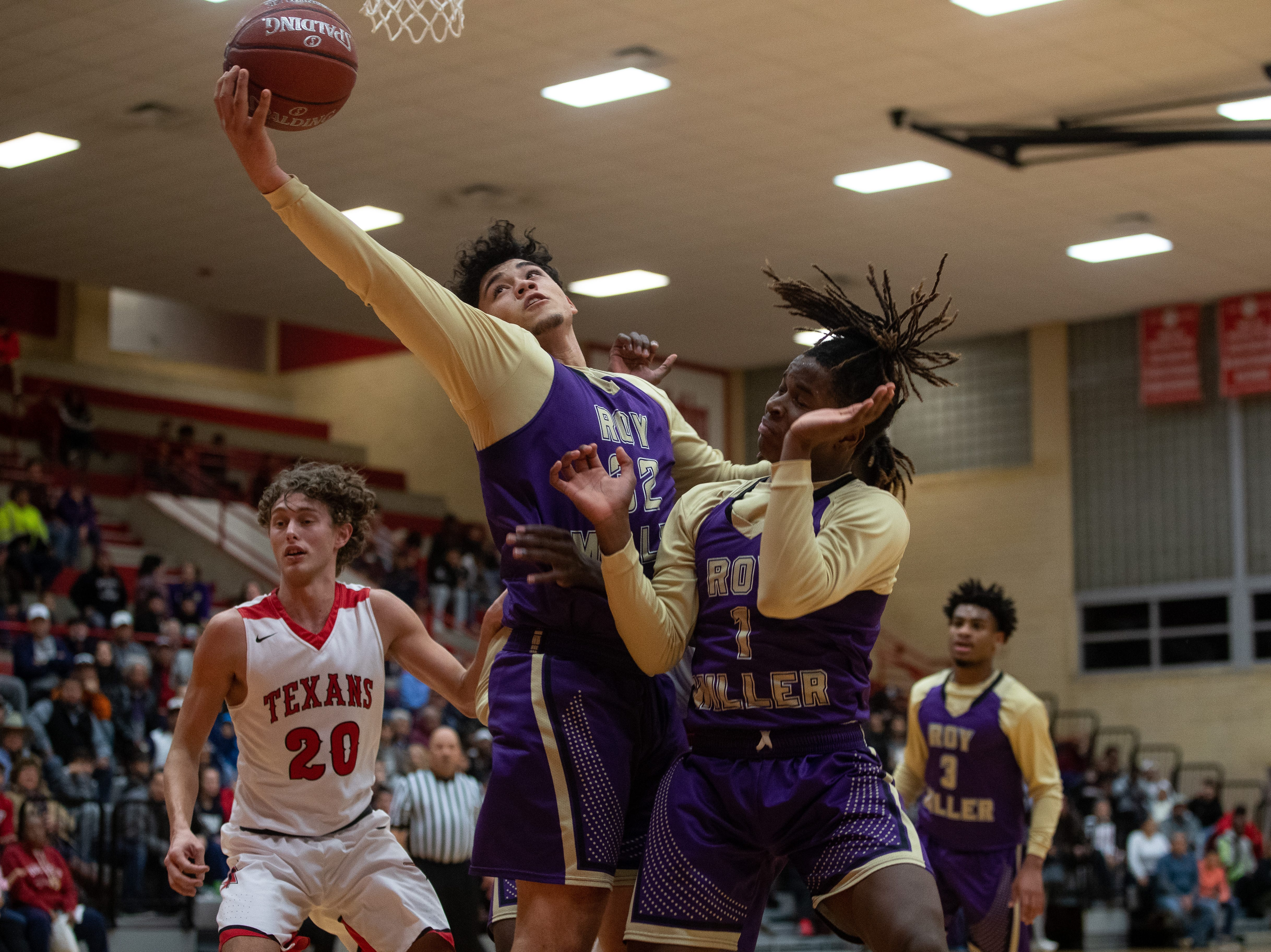 Miller's J.D. Reid reachers to make a rebound during the second quarter of their game against Ray at Ray High School on Wednesday, Jan. 2, 2018.