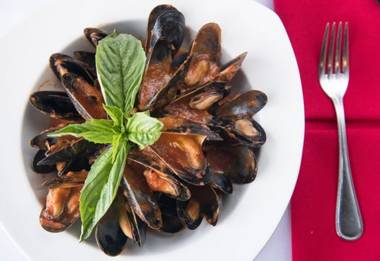 A plate of mussels in red sauce is on the menu in The Kitchen Consigliere restaurant in Collingswood.