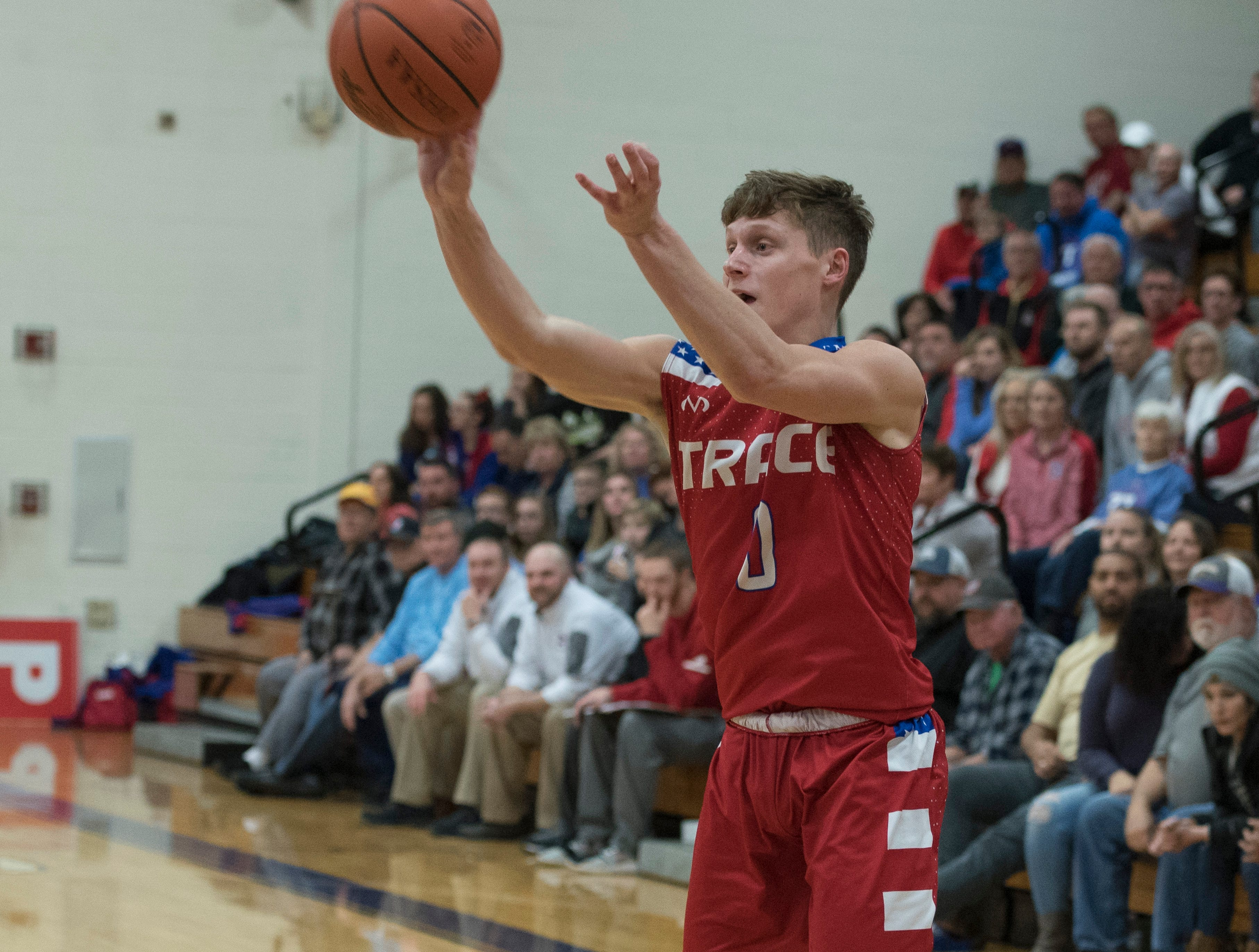 Junior Colby Swain takes a jump shot to score for Zane Trace Wednesday night at McClain High School. McClain defeated Zane Trace 61-60.