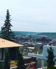 A view of Over-the Rhine and Music Hall from a walkway in Mount Adams is just one of many vistas to take in during a stroll of this hilly neighborhood.