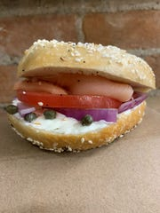 A lox sandwich from OTR Bagelry with lox, tomato, onion, capers and cream cheese