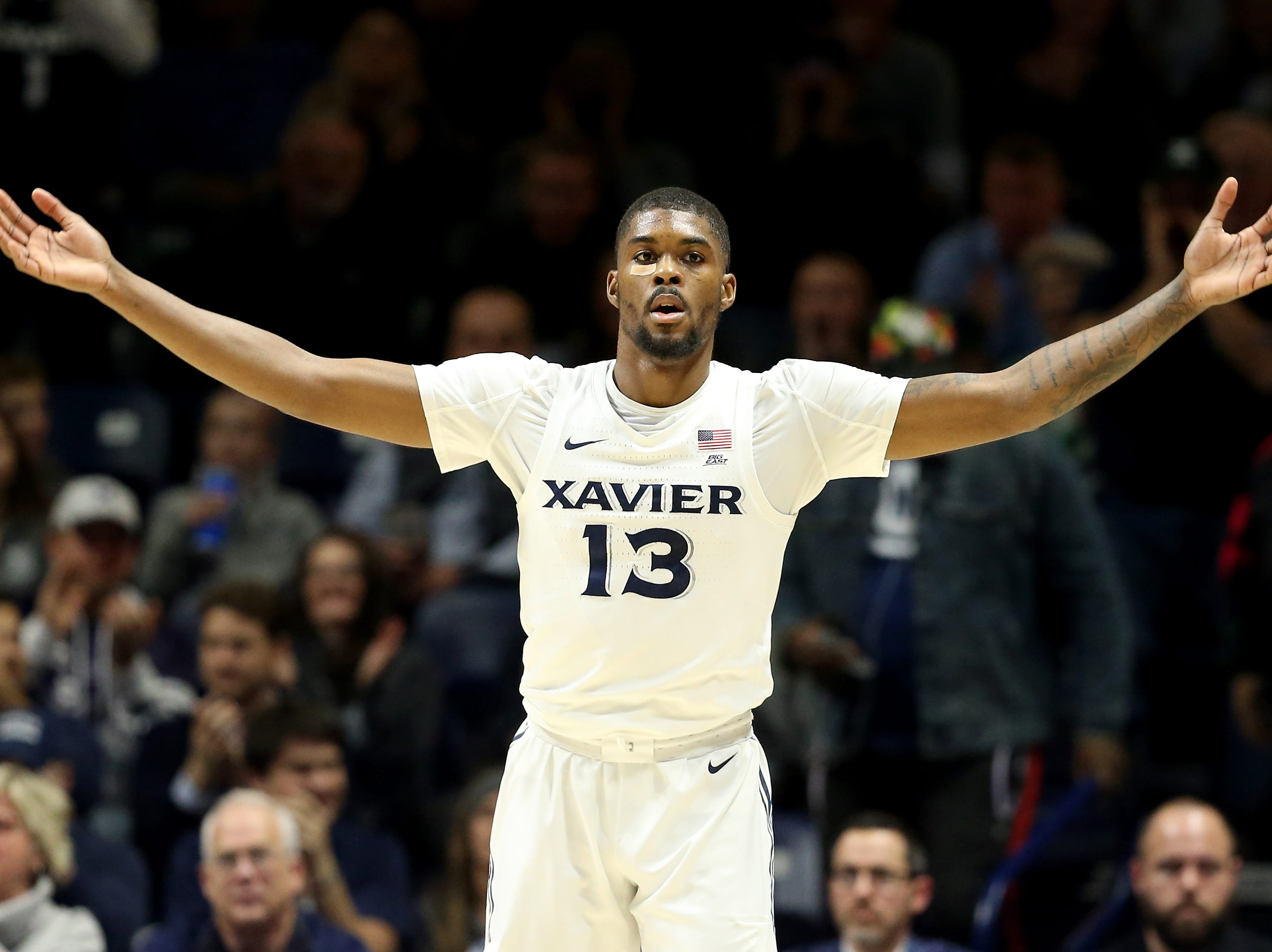 Xavier Musketeers forward Naji Marshall (13) pumps up the crowd in the first half of an NCAA college basketball game against the Seton Hall Pirates, Wednesday, Jan. 2, 2019, at the Cintas Center in Cincinnati.
